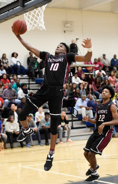 Warner Robins' Nelson Phillips (10), goes up for a dunk at Northside Saturday.
