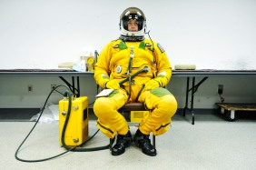 NASA ER-2 pilot Stu Broce, Meat, sits in his pressurized flight suit before his 8-hour flight Wednesday. Broce breathes pure oxygen for one hour before his flight to remove all the nitrogen from his blood. The suit is similar to the space suits that astronauts use in space flights.
