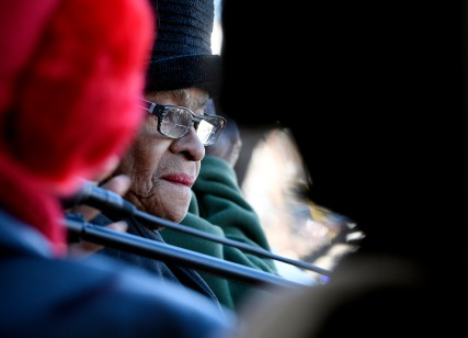 Lucile Clark, 83, looks out over the Martin Luther King Jr. Day marchers at the Macon-Bibb Governmental Center.