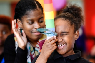 "Makayla Rideau, a 10-year-old 5th grader at Southfield Elementary, smiles as she sees colors in a homemade spectroscope. She and about 70 of her schoolmates were participating in ""Lights On Afterschool"" a nationwide event celebrating after school programs and their role in keeping kids safe, inspiring them to learn and helping working families. Southfield's event was hosted by the Museum of Arts and Sciences featured STEM activities and a animal show."