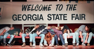 Volunteers from the audience fall into a deep sleep after being hypnotized by Hypnotist Steve Bayner during the Steve Bayner Hypnotist Show at the Georgia State Fair in Macon.
