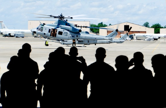 Members of the HMLA 773 watch as the pilot lands their new Huey on the flight line in front of the hanger. The helicopter is the first brand new helicopter the unit has added in 20 years. The aircraft was flown in from Texas.