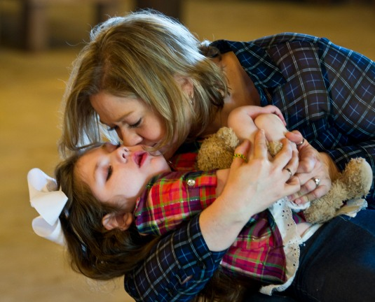 Janea Cox kisses her child Haleigh, the girl who launched Medical Marijuana in Georgia. There will be a benefit at The Barn in Colloden for the family that continues to struggle with her care and recovery from a fire.