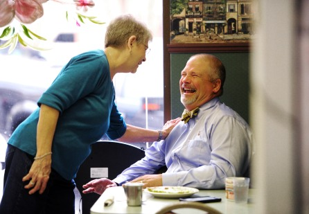 Barbara McGahee laughs with Judge Tillman Self III as she serves breakfast at Jeneane's Cafe. McGahee has been a waitress at the restaurant for 44 years. December 24th will be her last day as she retires to take care of her mother of also worked at the restaurant for years.