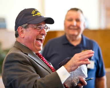 Macon Mayor Robert Reichert laughs as he tells the story of moving the model of the U.S.S. Macon from the Centerplex back to the lobby of the Macon-Bibb Government Center.