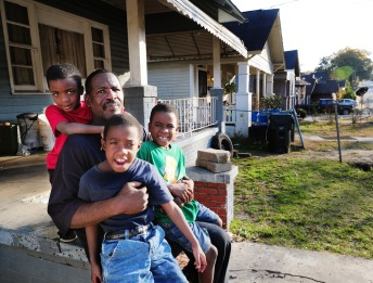 "Cordelia ""Carl"" Bailey with his nephews, John, 6, Anthony, 8, and Trey Wiggins, 6."