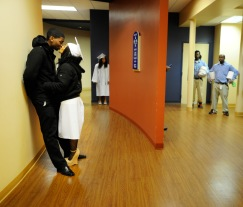 Tyerra Woodson and her boyfriend Joshua Marks share a kiss in a hallway of the Anderson Center Tuesday night. Woodson was graduating with a Pharmacy Technician certificate from the School of Heath Macon Campus. Almost 100 people received certificates in areas ranging from barbering and cosmetology to surgical technician. The Helms College, Polly Long Denton School of Hospitality had 17 diploma of culinary arts and 2 certificates of culinary arts.
