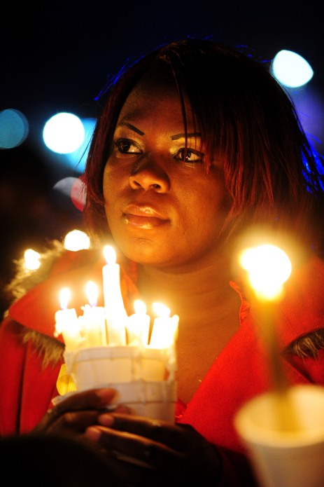 Elissia Dotson holds her candles at the candle light vigil held in memory of Jai'mel Anderson, 8, who was shot to death at an Indian Oaks Apartment. About 100 people attended the candlelight vigil at the gazebo in downtown Fort Valley.