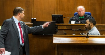 Prosecutor John Regan points as he questions Keith Dozier during cross examination. Dozier, the remaining suspect in the Gail Spencer embezzlement-murder, took the stand in his own defense.