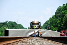 An Averitt truck was knocked on its side and pushed some 50 feet up the tracks by a Norfolk Southern train moving north at about 1:45 p.m. in Bolingbroke.